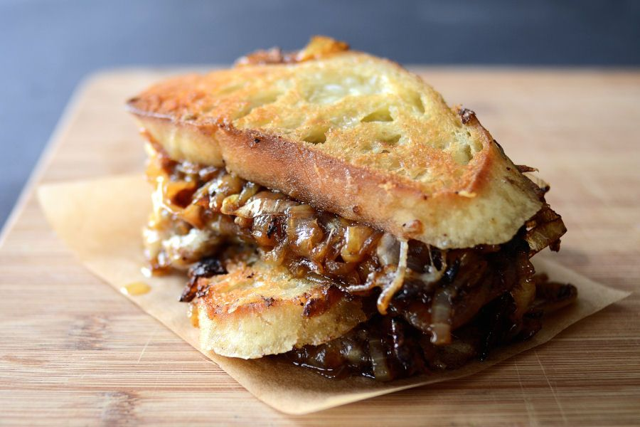 """French onion soup grilled cheese sandwiches. Made on sourdough bread with gruyere and carmelized onions. Lots. And lots. Of onions. Repin if you like your sandwiches """"wit"""" onions."""