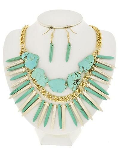 Make a statement with this turquoise and gold necklace.