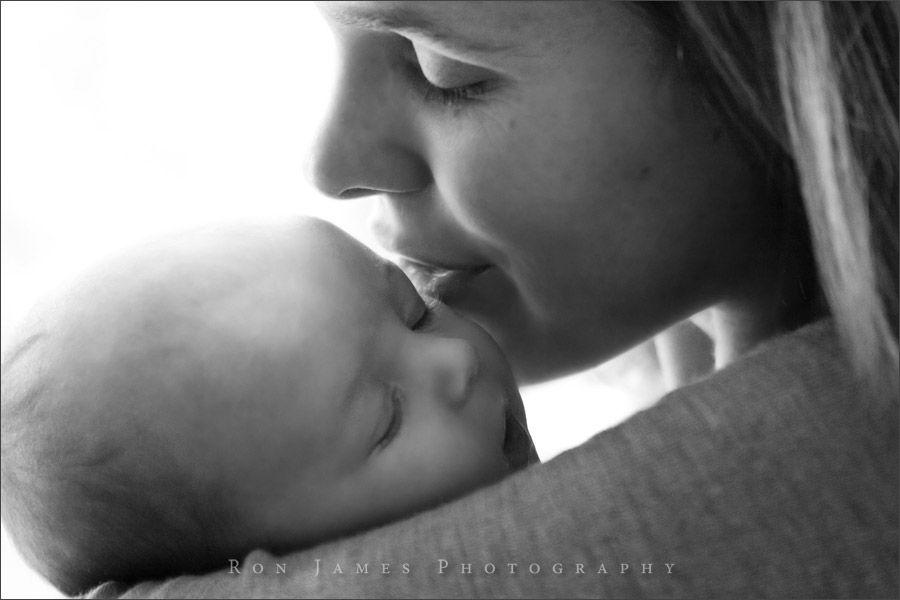 mom-whispering-in-babys-ear