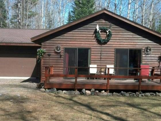 Adorable And Cozy Cedar Sided Home Tucked In The Woods Home Has Large Great Room With 2 Sets Of Sliding Doors That House In The Woods Great Rooms Cedar Siding