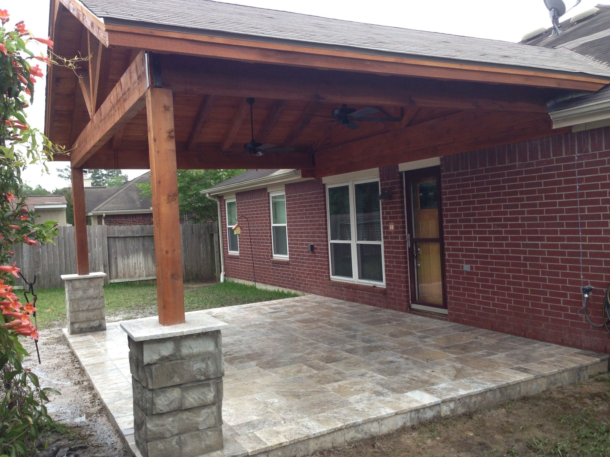 Gabled Cedar Patio Cover With Travertine Paver Patio And Chopped Stone Post Wraps Spring Tx By Www Primooutdoorliving Com Patio Backyard Patio Paver Patio
