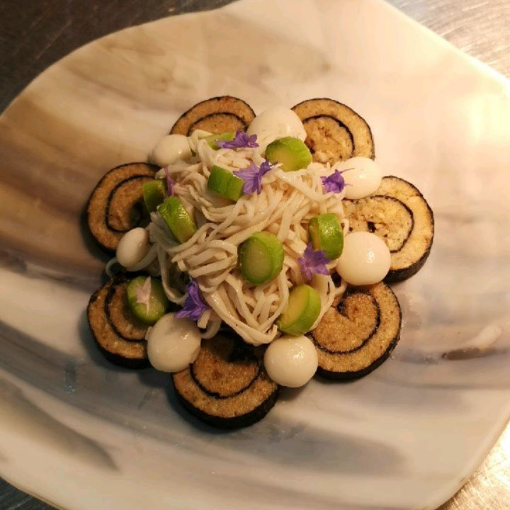 King oyster mushroom noodle shitake roulade thickened mushroom dashi and mushroom chicharon on the…