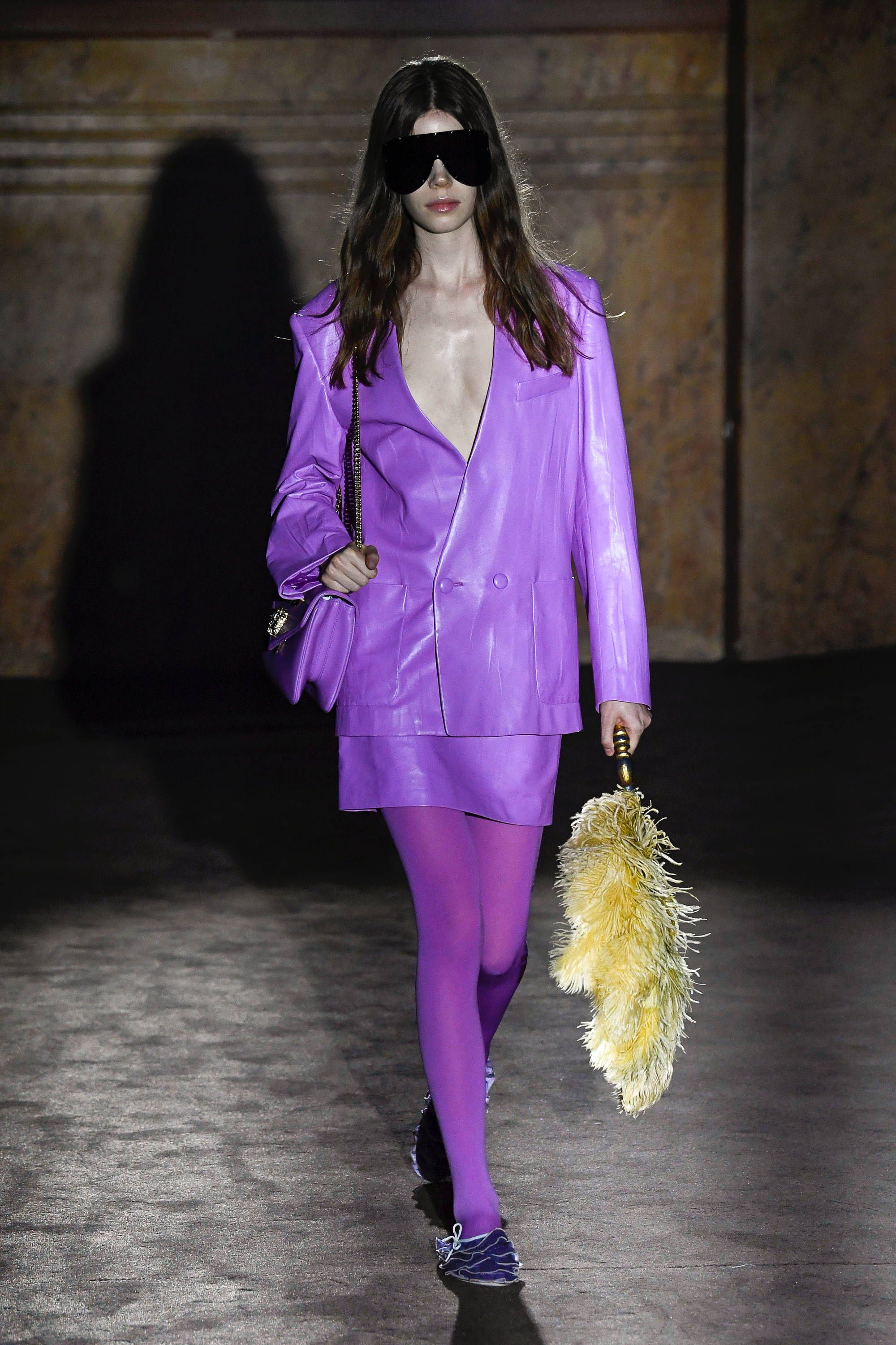 663a0ea62 See every incredible look from the Gucci spring/summer 2019 show, including  this purple leather jacket and skirt, worn with wraparound oversized black  ...