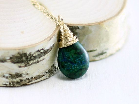 A polished, green and blue azurite malachite stone is wire wrapped in 14k gold…