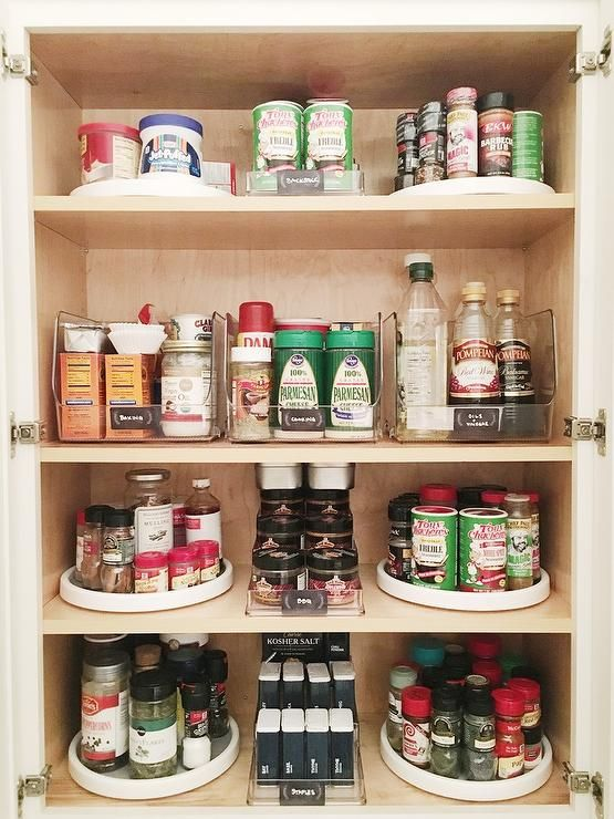 kitchen cabinets open to a pantry filled with small lazy susans filled with spices lazy susan on kitchen organization lazy susan id=95612