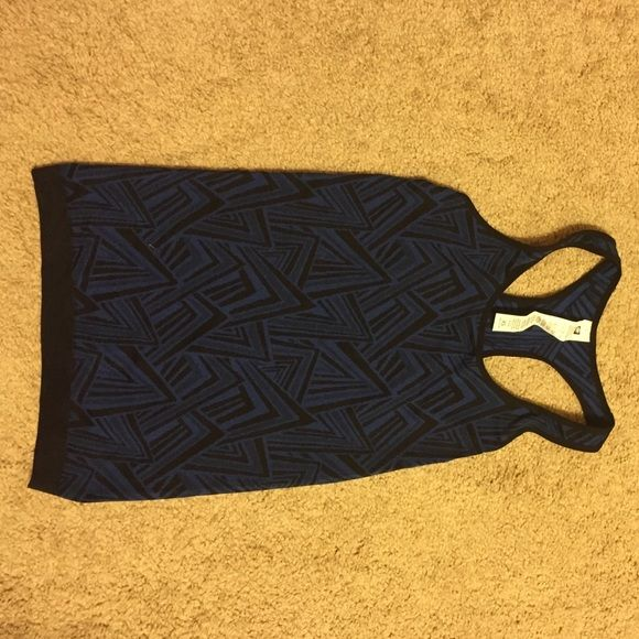 Fabletics blue peak print Olympus tank XS Fit: Fitted. Runs True To Size. Length Hits At Thigh.Length: Hip Fabric Content: 63% Nylon/32% Polyester/5% Elastane Features: Soft, Seamless Construction, Racerback Shape, Textured Jacquard Design Imported Fabletics Tops Tank Tops