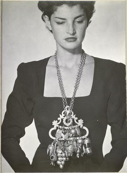 Man Ray    1946 Juliet / wearing a roma tin amulet