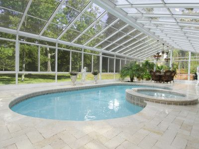 This Four Seasons Cathedral Style Sun Room Encloses A Pool From The Outdoor Elements It Is Now Easy To Enj Pool Enclosures Patio Enclosures Four Seasons Room