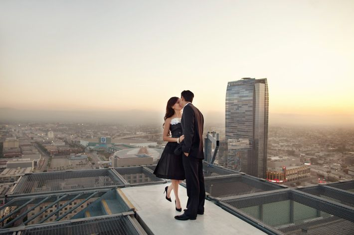 downtown los angeles rooftop high rise engagement photography helicopter pad engagement photography
