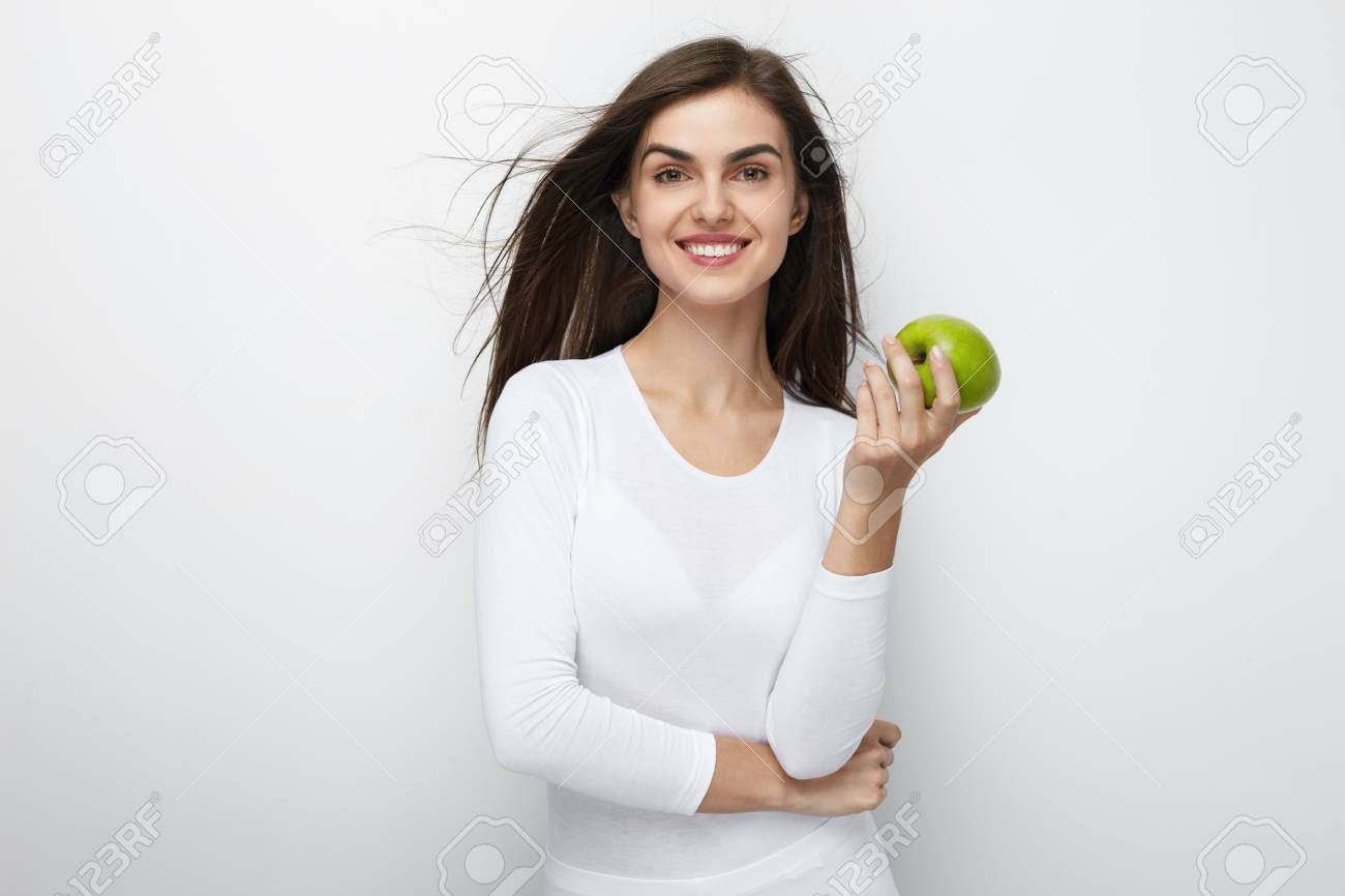 Woman With Green Apple Beautiful Smiling Female With White Smile