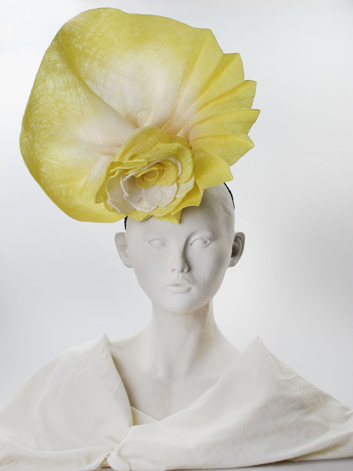 Pinokpok headpiece. Summer wear. Free size (front view)   Mary Franck   Yellow and ivory pinokpok headpiece, dip-dyed and pleated, with a central rosette. From the 'Pop' collection. Secured by an elastic cord   Made in England