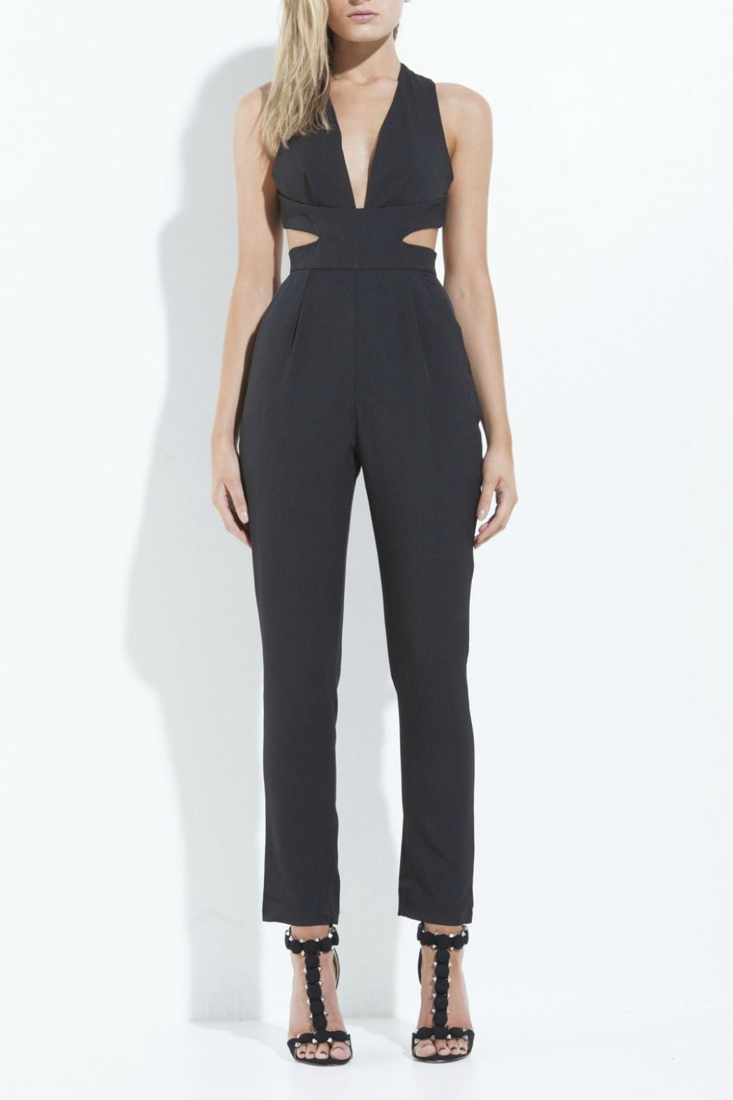 ab2591d192 Structured jumpsuit with low neck and cutouts on sides. Crossover back  detail and invisible zip closure at back. Fully lined. Composition  65%  Cotton  35% ...