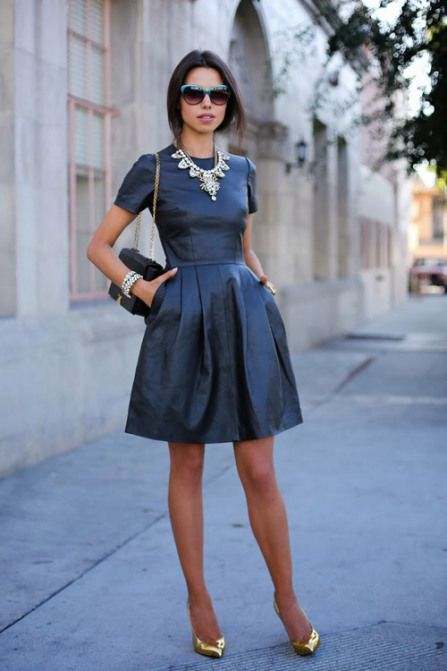 25 new years eve outfit ideas - short sleeve 'fit and flare' leather dress + gold statement necklace and pointy-toe heels