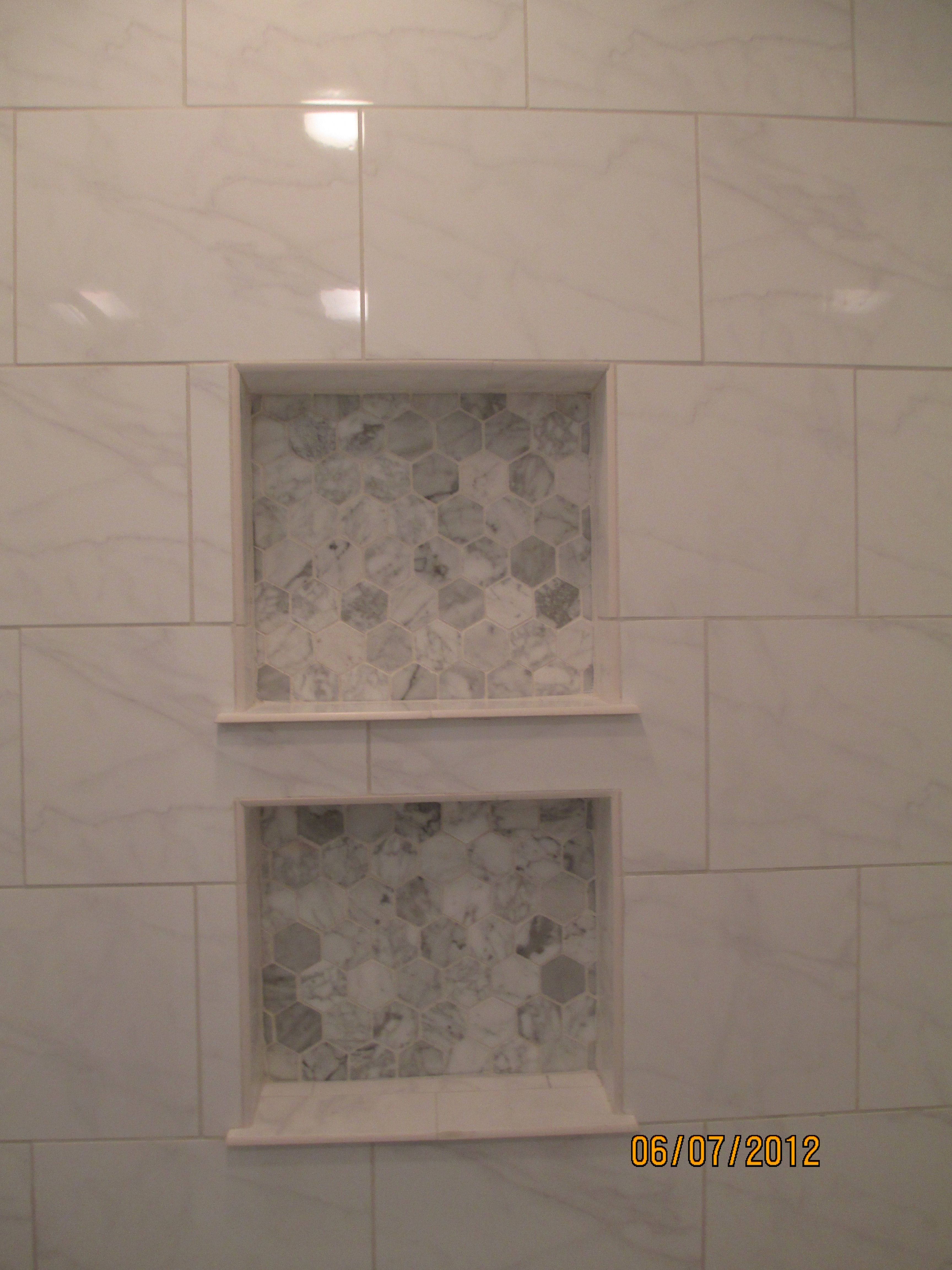Hexagon Carrara Marble Tile In Back Of Shower Niche. Red River Remodelers