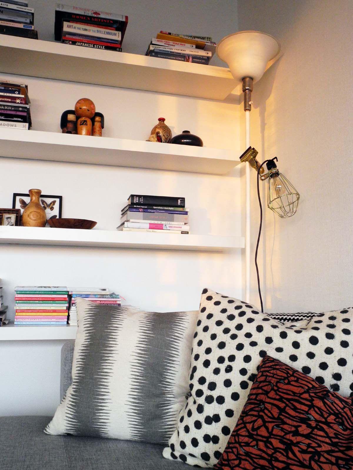 floating shelves, clamp lamp, pillows