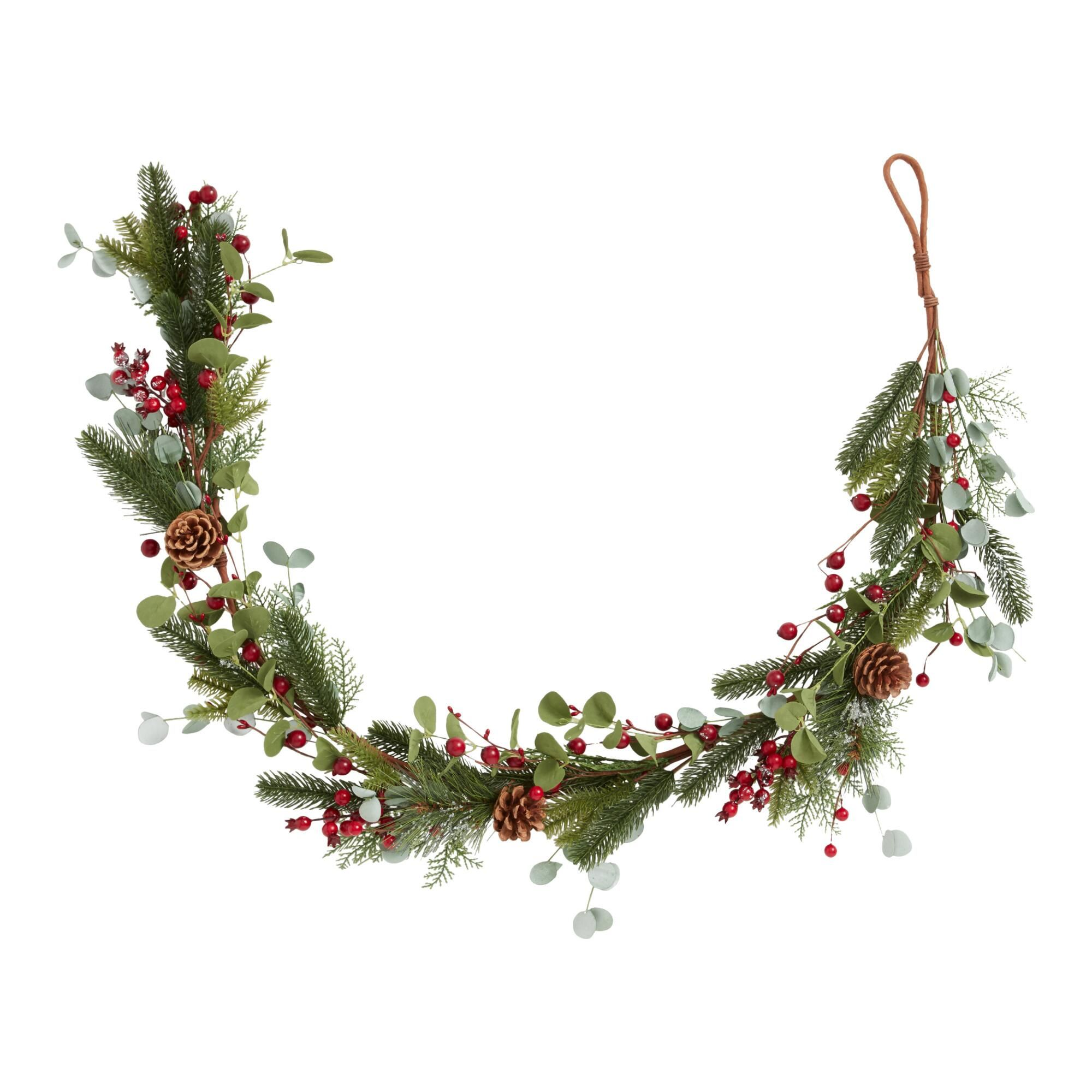 Wreaths -Wildly lush and classically festive, our holiday garland is festooned with sprays of faux eucalyptus, frosted pine, red berries and real pinecones. Material: Plastic, Color:Multi. Also could be used for seasonal,gifts,home decor,decor,christmas decor,holiday decor,christmas decorations,holiday decorations,decorations,hanging decor,wall decor,ornament,holiday,christmas,xmas,holiday garland,porch decor,mantel decor,mantle decor,homestead holiday. By Cost Plus World Market.593938