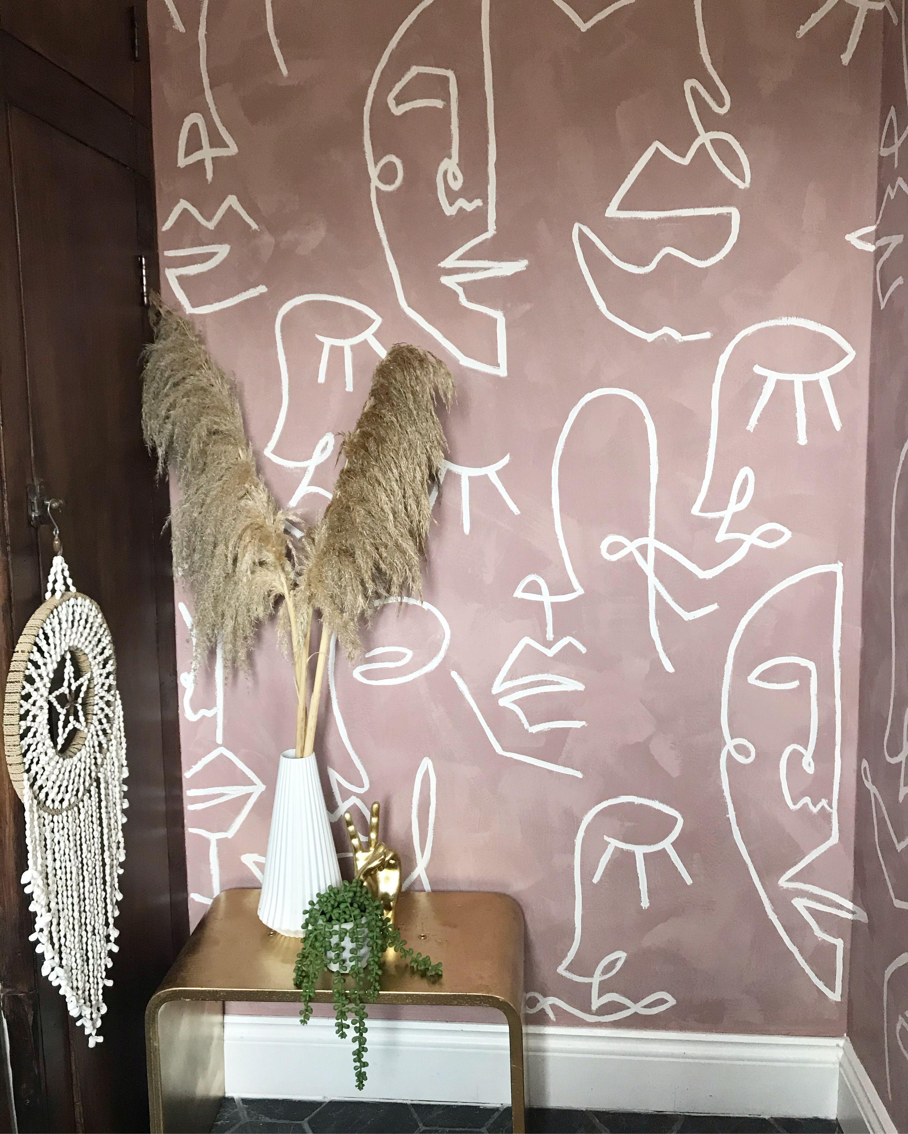 Hand painted ladies faces bathroom mural