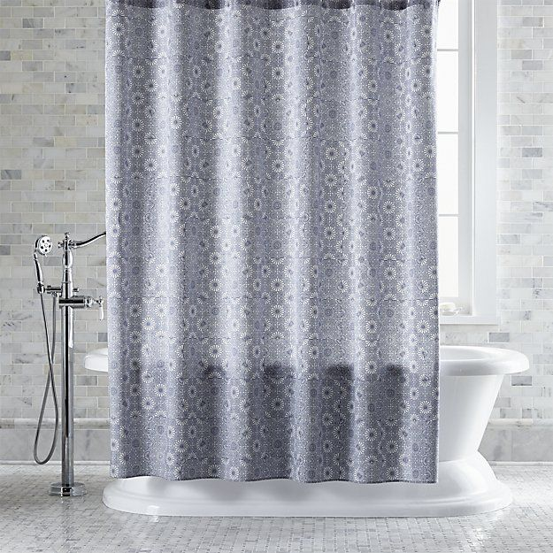 Delicate, dotted geometric botanical print in blue patterns this eye-catching cotton shower curtain with the look of Japanese textiles. The expressive Kioto design was originally created in 1976 by Maija Isola. Also available in grey.
