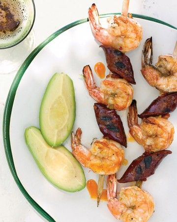 Alternate shrimp with pieces of Spanish cured sausage (chorizo) that's been cut on the bias to ensure easy threading and even cooking. After grilling, serve with avocado wedges drizzled with lime juice.