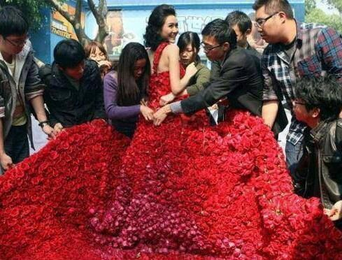 A man in China had 9,999 red roses sewn into a dress for his girlfriend. After she put the dress on he proposed. The number 9 in Chinese culture is said to represent 'forever'.