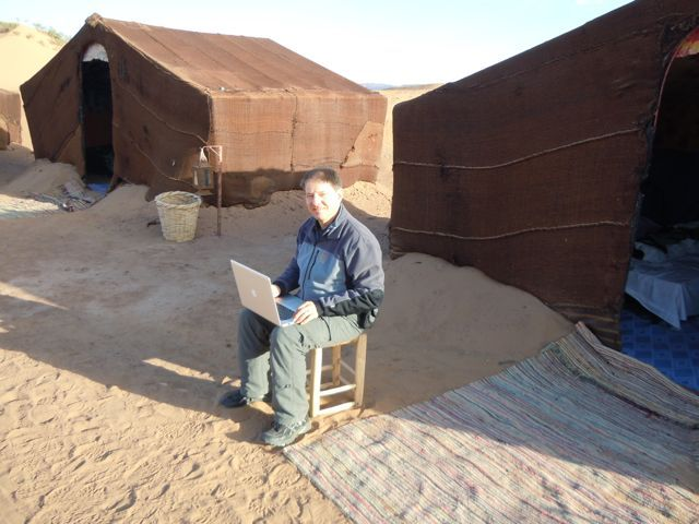 Laptop Lifestyle in the Sahara dessert near M'hamid, Morocco