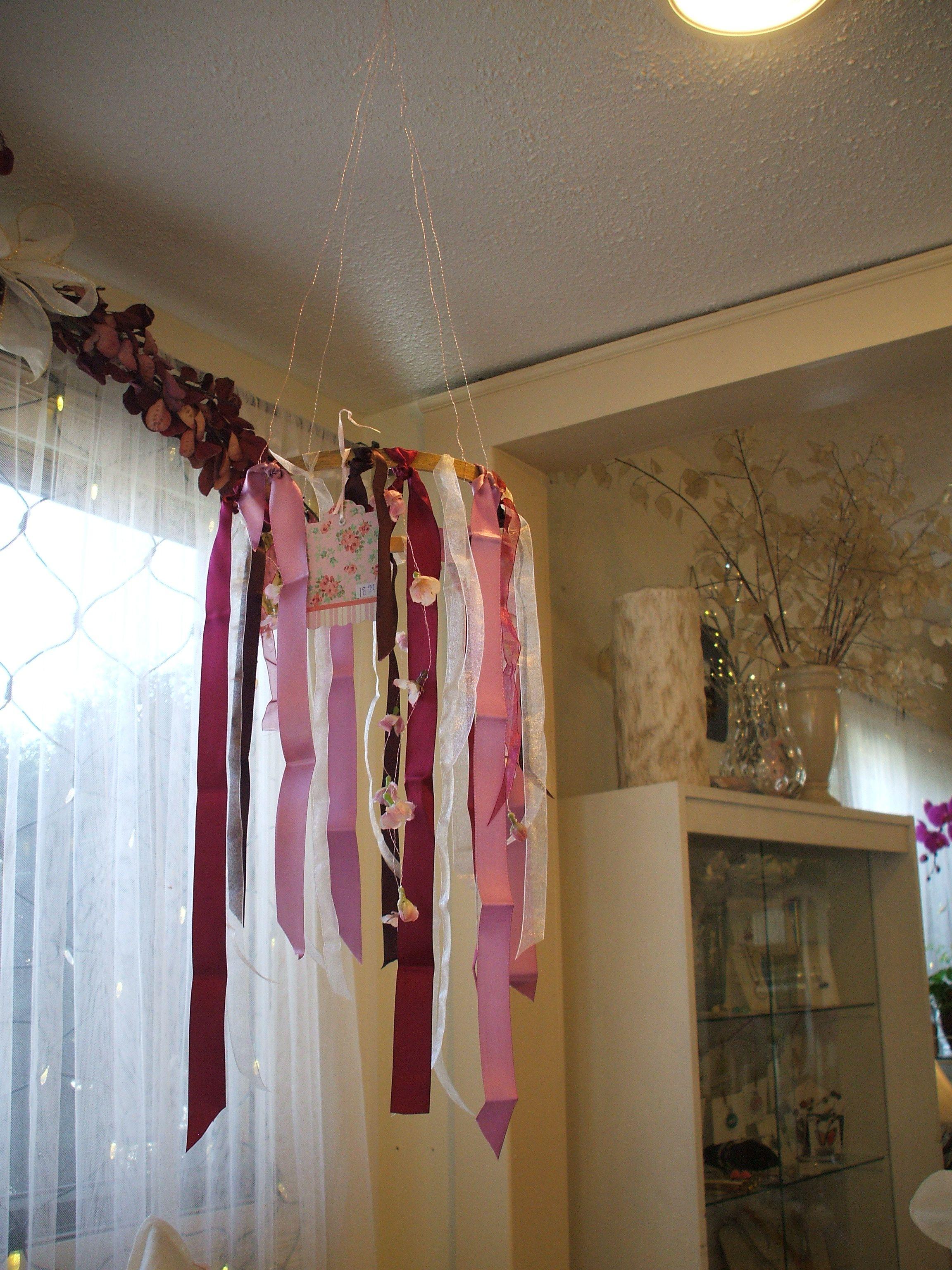 Rose ribbon chandelier created at A Flower Shop on Okanagan Avenue