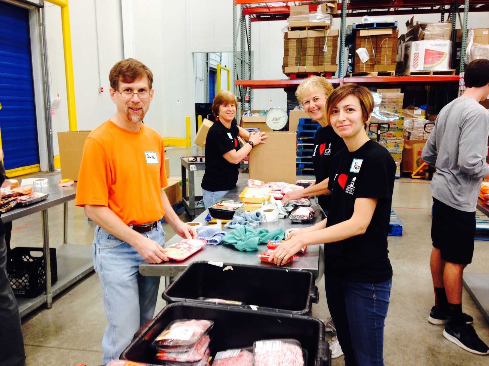 Cindy, Mary, Pam, and Cindy's husband, Dave at the Food Bank