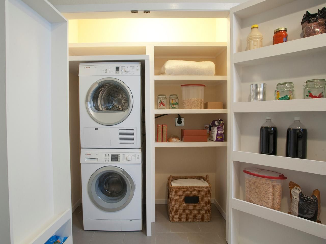 A Stacked Washer And Dryer Allows Ample Room For Convenient Storage Space  In This Laundry Closet