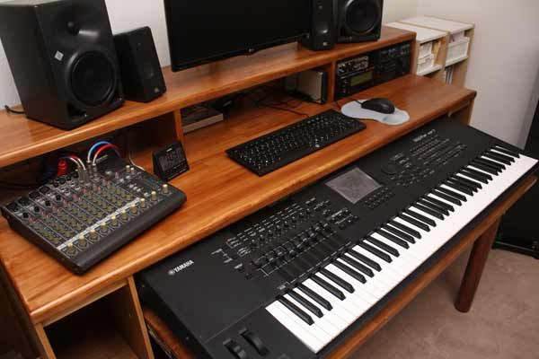 Close up of the desk surface, with music equipment on ...
