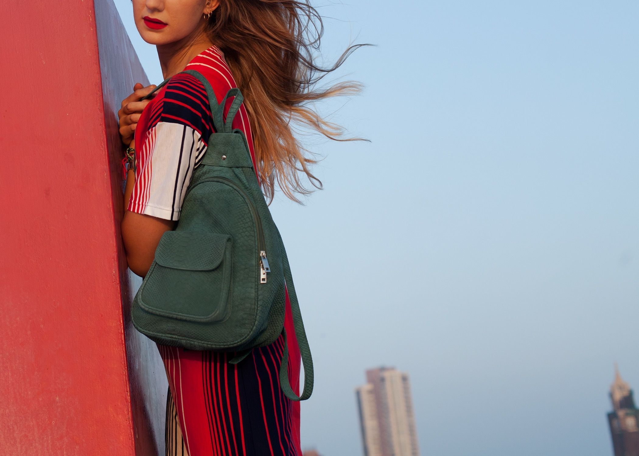 BBco backpack in Sage made from sustainably sourced buffalo suede and lined with cream faux-kid. Shot in Bombay and modelled by Pauline de Muizon.