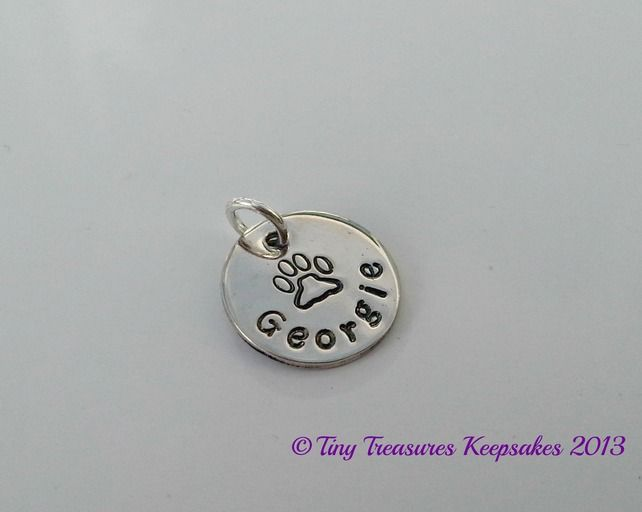 Sterling silver charm with a handstamped pawprint and pet's name £12.00