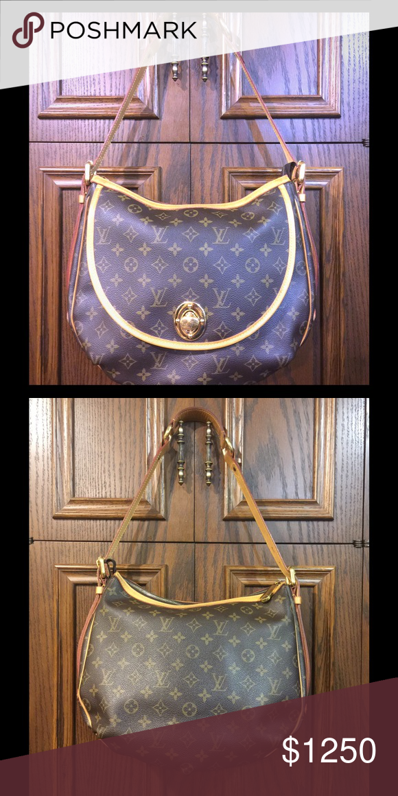 Louis Vuitton GM Tulum Great bag, has light scratches on front gold turn lock and zipper pull, front pocket and 2 cell phone pockets inside. Super cute bag. Louis Vuitton Bags Shoulder Bags
