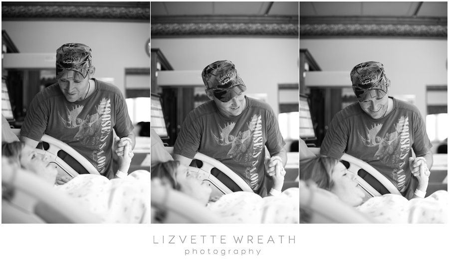 Husband supporting wife during the delivery of their daughter.  >>Tampa Bay Area Birth Photographer