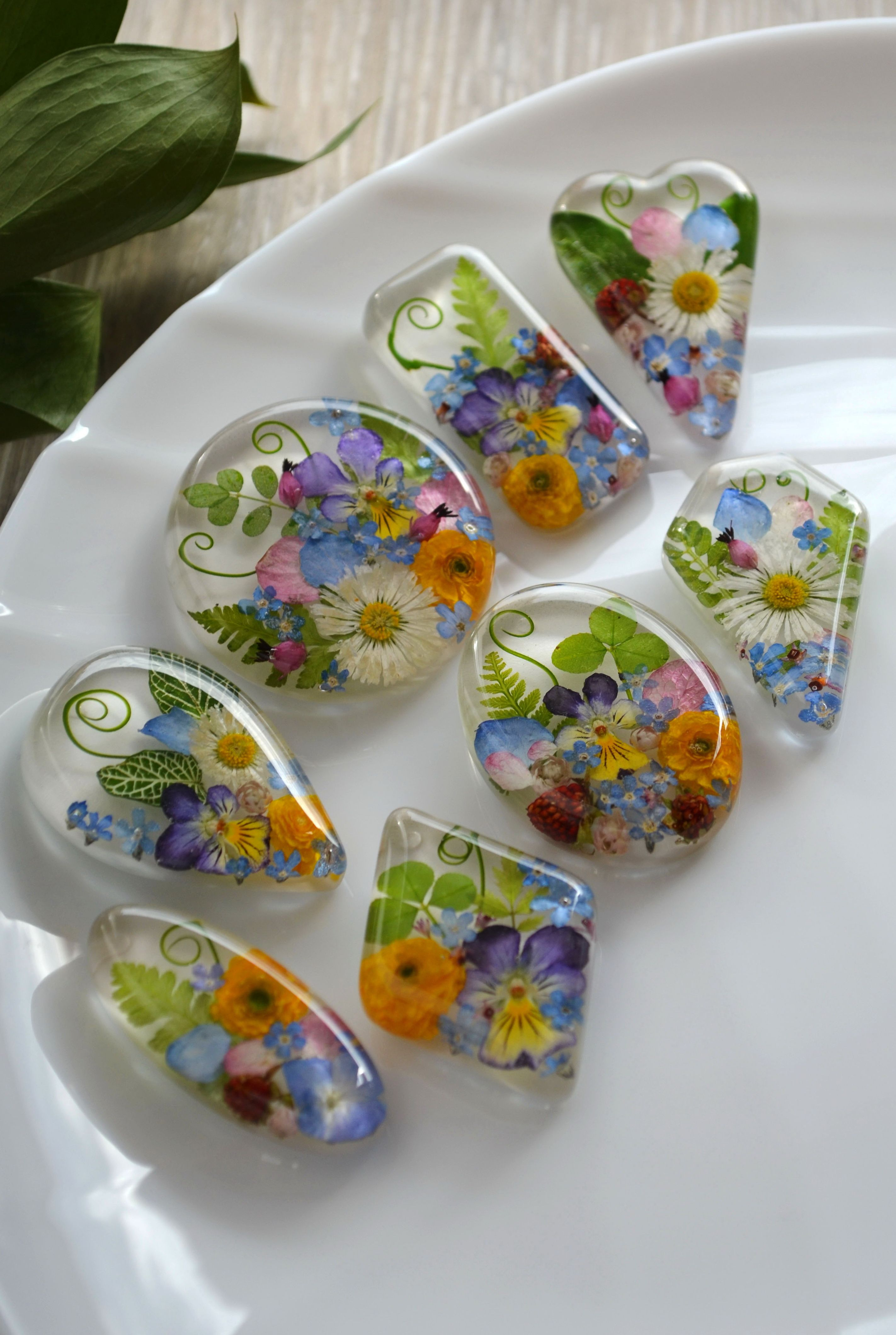 Photo of Pendant with a pansy in resin. Necklace with buttercup, forget-me-nots, hydrangea and fern.