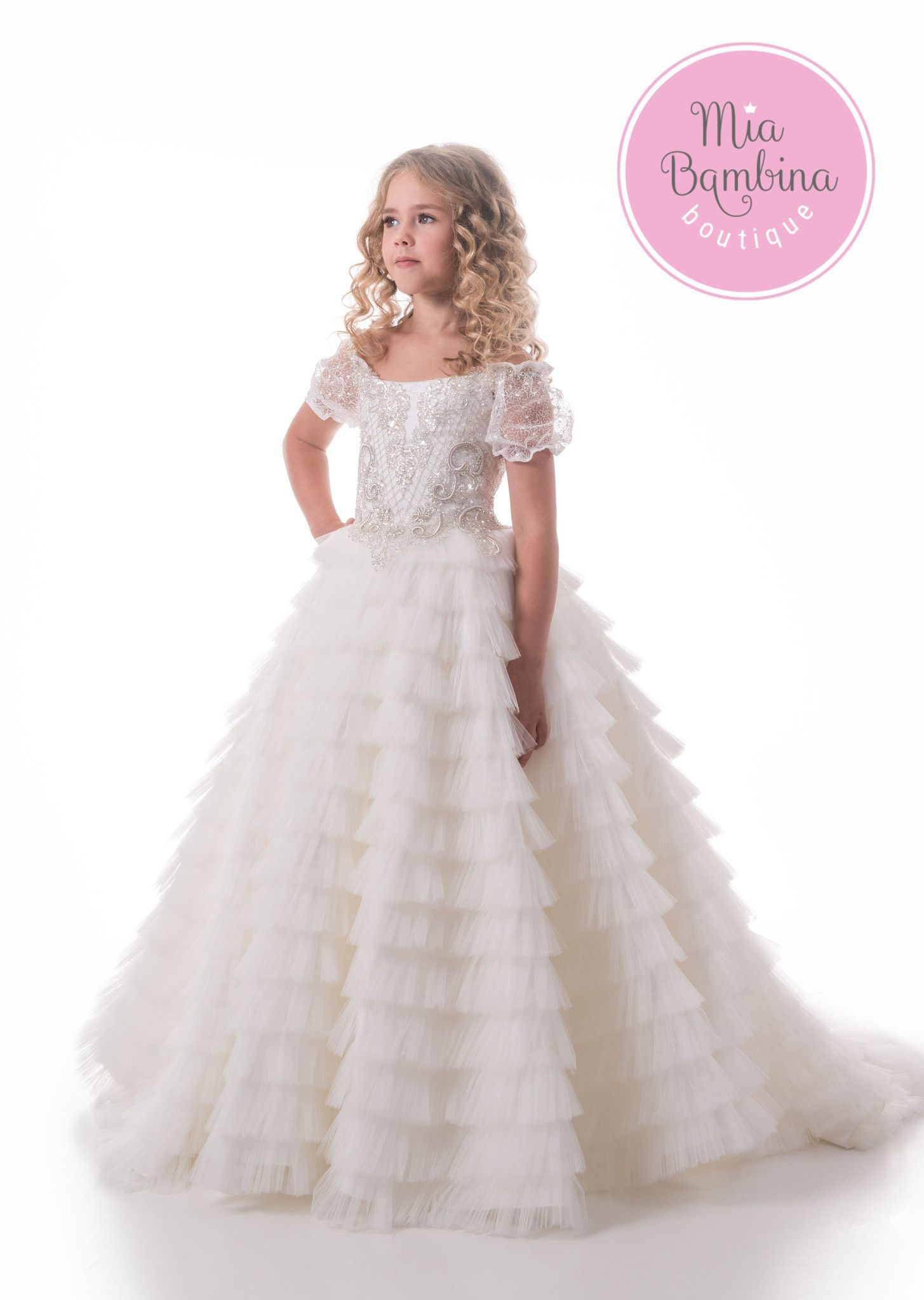 e180525e6225 The absolutely gorgeous flower girl dress features a full ruffle tulle floor-length  skirt and sheer lace cup sleeves. The dress back grabs your attention ...