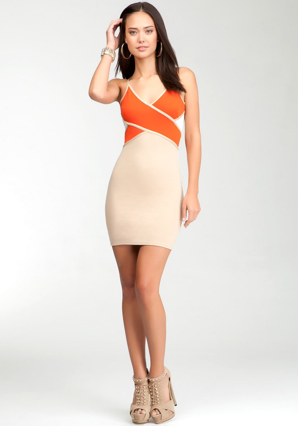 Where bright meets neutral, this bebe bodycon dress features a crisscross design at front and a heavy stretch that holds you in. Try it with a moto jacket to up the charm.