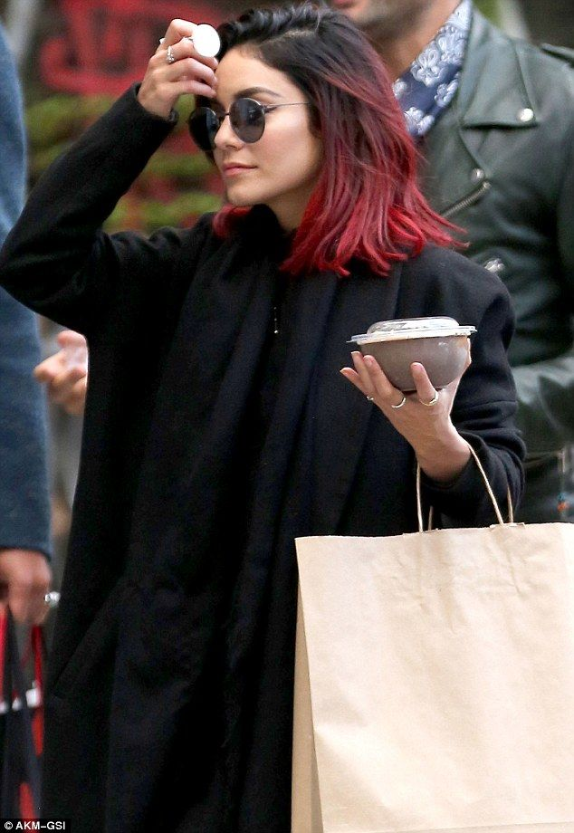 Vanessa Hudgens covers up in all black on a New York outing with beau