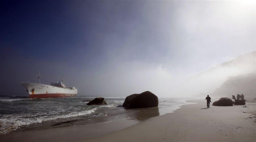 Fishing trawler runs aground off Cape Town beach.