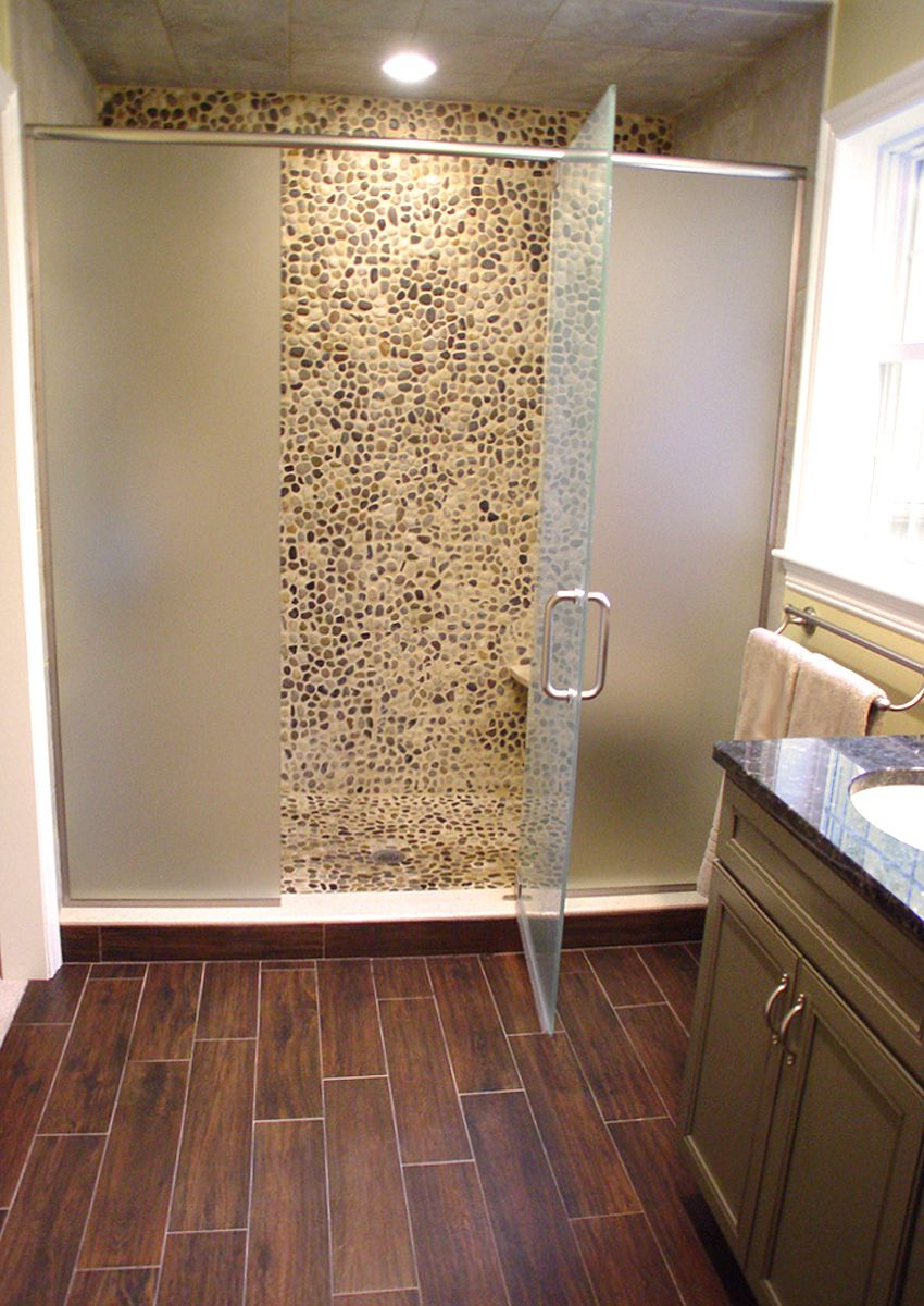 Wood tile pebble rock shower floor yes master bath Bathroom ideas wooden floor