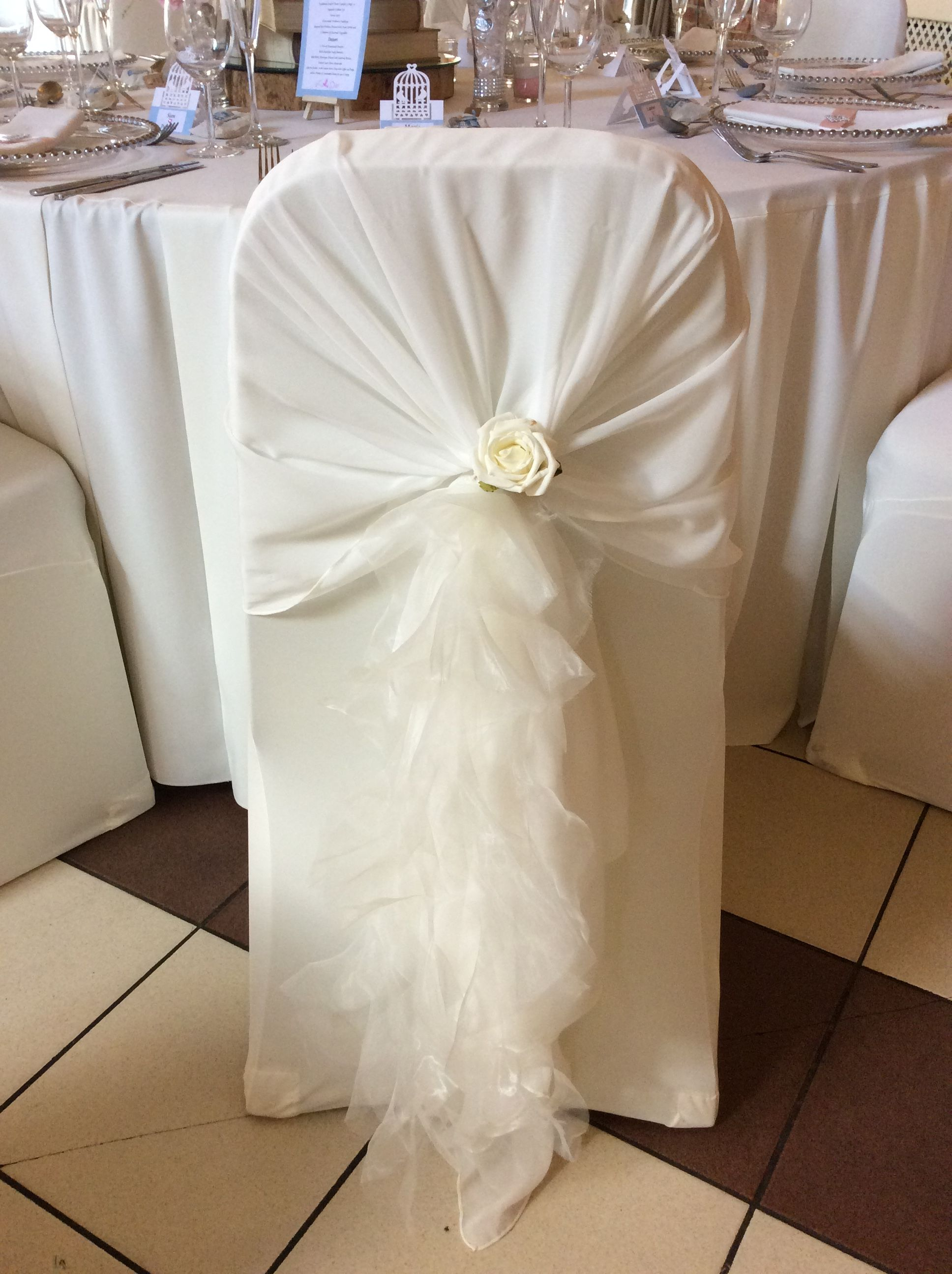 Ivory chair cover chiffon hood and frill with ivory rose detail