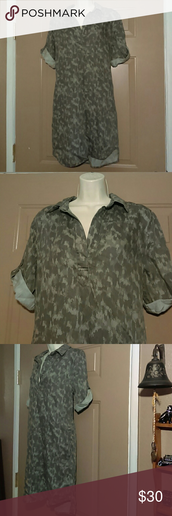 """NWT PHILOSOPHY SHIRT DRESS-SIZE MEDIUM -Brand New with Tags -Philosophy Shirt Dress -Size Medium -100% Tencel Lyocell -Kinda has a Camo look -Has collar with a V-neck -Sleeves are rolled up and secured with strap and button -Armpit to armpit measures 20"""" -Shoulder to bottom hem measures 35"""" in front and 37"""" in back -Hidden pockets on each side of dress -Nice looking dress and very comfortable Philosophy Dresses"""