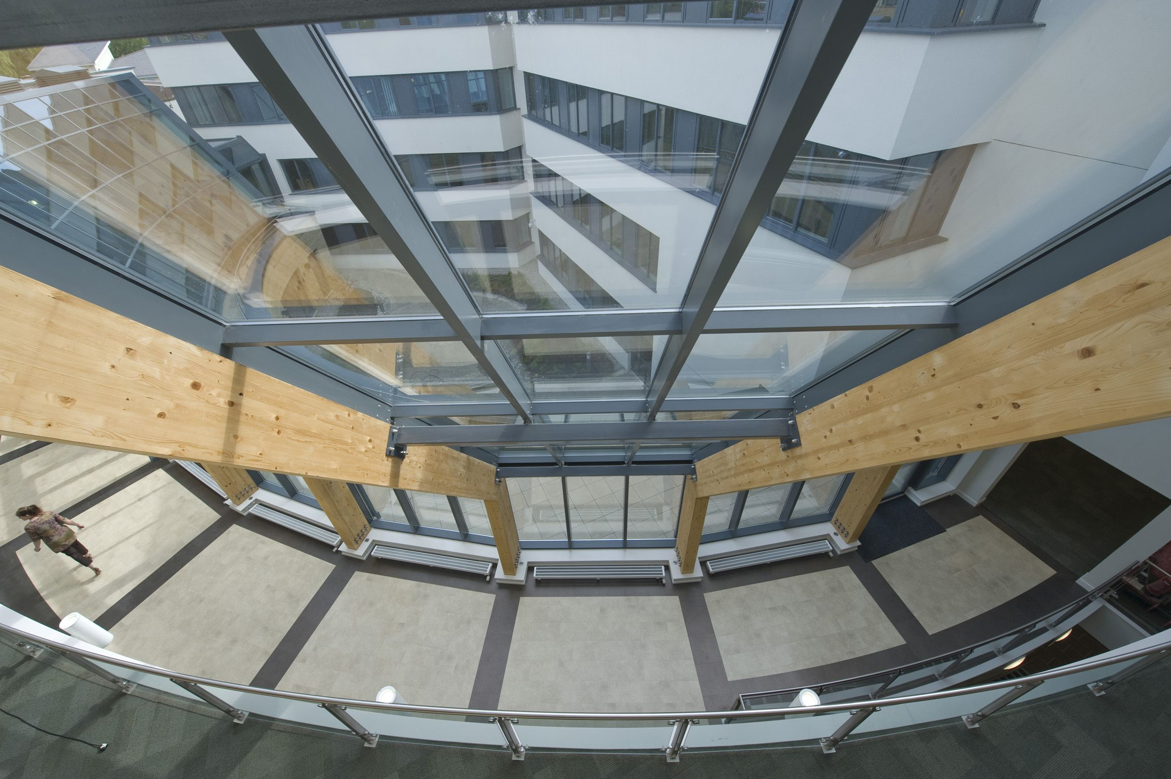 Curtain Wall Faceted Glazed Grid Installed To Glulam Structure