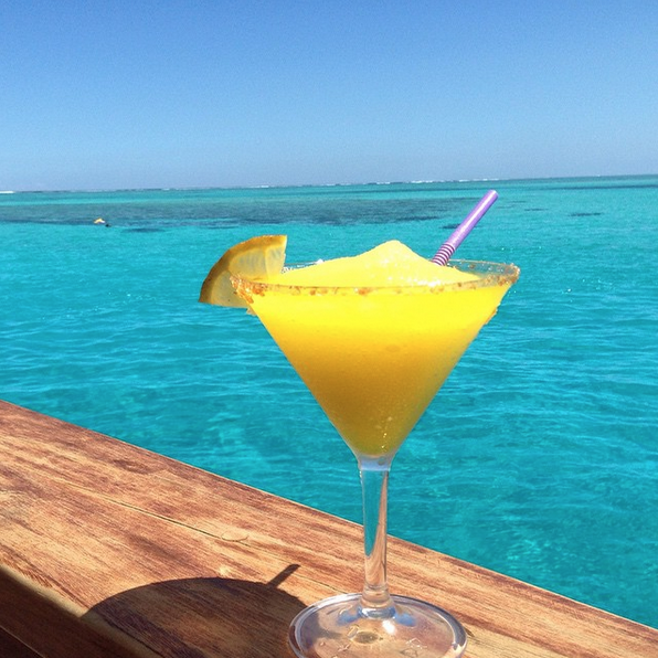 Happiness = a colourful cocktail with an ocean view. 📷 IG ...