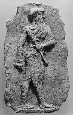 """""""Molded Plaque with a king or god carrying a mace""""- early Babylonian period 2000-1700 BCE,"""