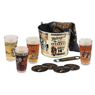 Harley Vintage Race Day Bucket set. Includes 4 pint glasses, each with a different  unique, nostalgic race day graphic, 4 Tin coasters, a Bar towel, and  a metal bottle opener all packaged in a 5 qt Metal bucket for your ice. A bar gem!