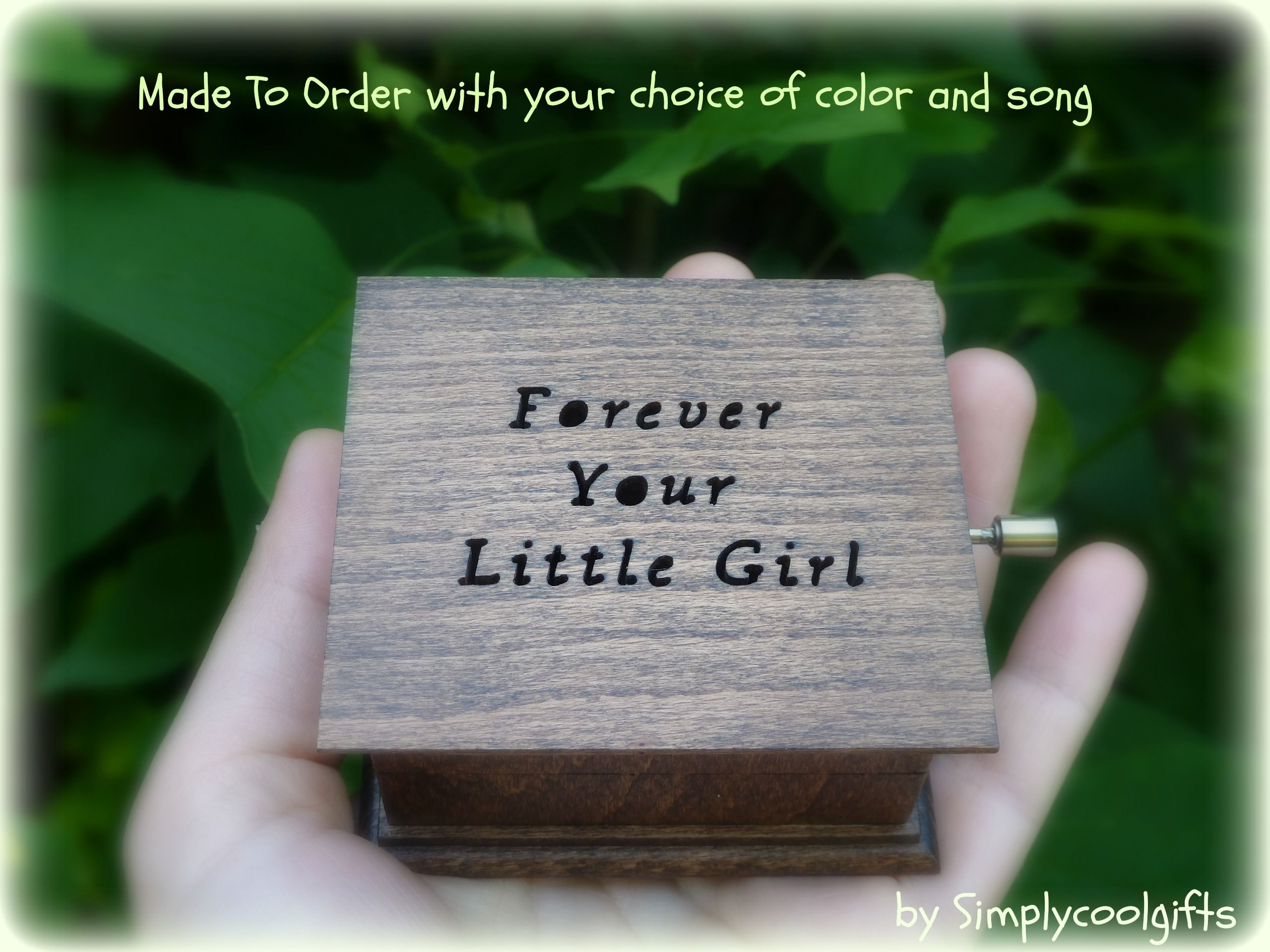 These have the crank on the side of the wooden box, these music boxes play the song while you are turning the handle! If you stop turning the handle, the music stops playing as well!  These music boxes can have open lids or they can be sealed shut! You can check them out here: https://www.etsy.com/shop/Simplycoolgifts?section_id=11242244&ref=shopsection_leftnav_1