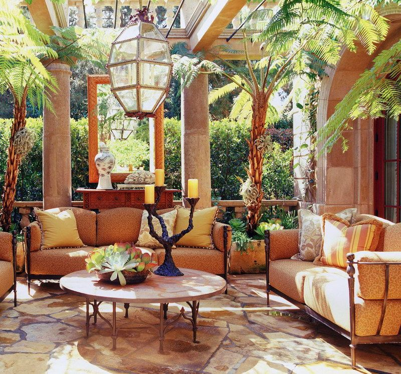 Tuscan Patio idea Love the glass ceiling and the large mirror