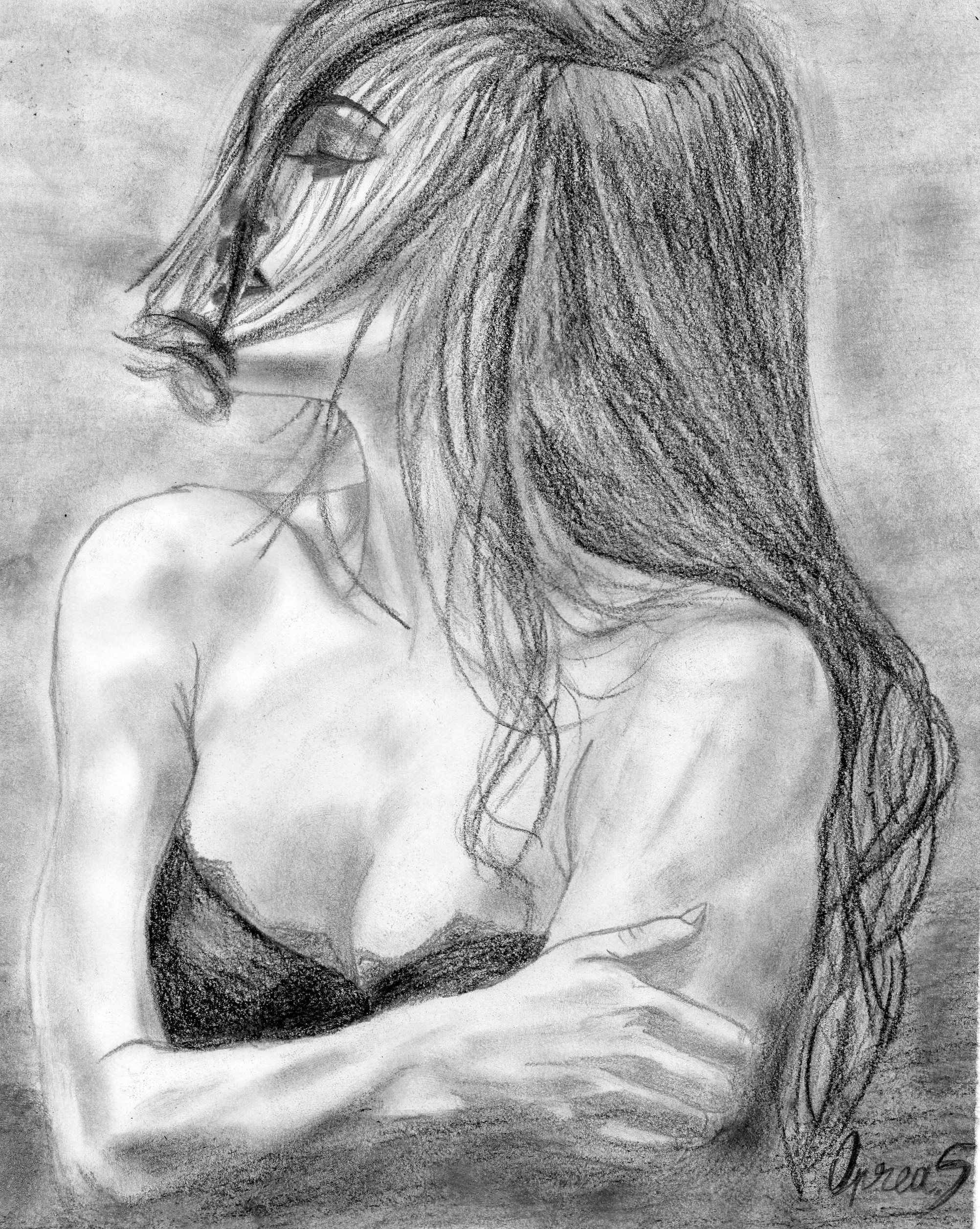 Thoughtful beautiful woman drawing