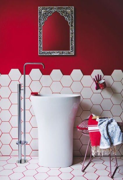 Red wall in bathroom with white hexagon tiles & RED GROUT! Love or loathe? :)                                                                                                                                                                                 More