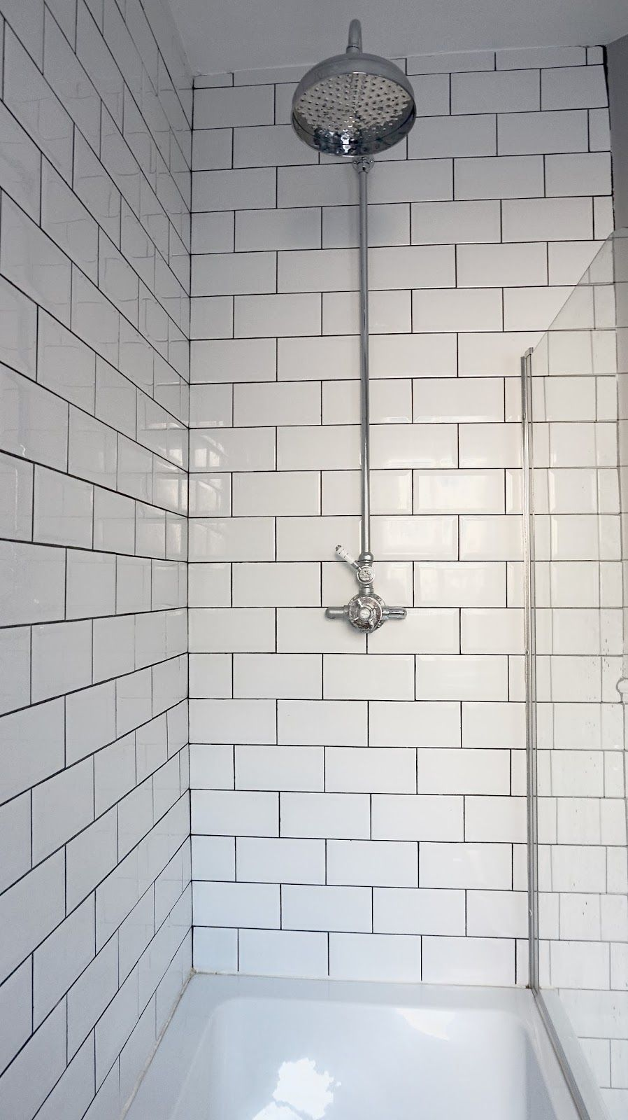 Bathroom Transformation Shower With White Metro Tiles And Grey Grouting